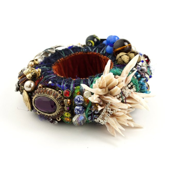 A statement bangle made of new and re-claimed components found during countless trips to antique markets.