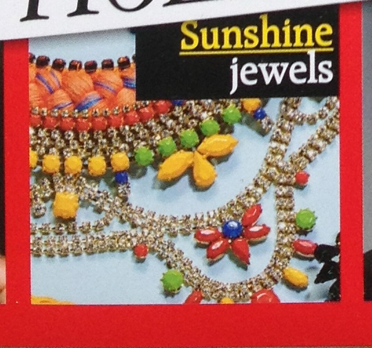 A colourful Alexandria statement necklace by Jolita Jewellery on the cover of the magazine.