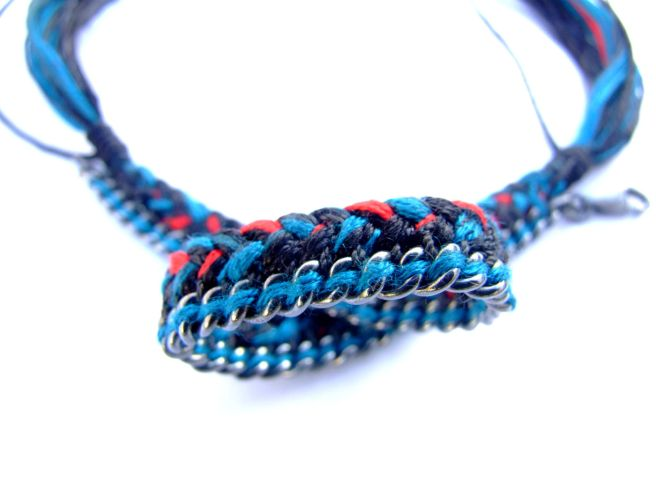 One-of-a-kind unisex aged sterling silver curb chain bracelet with braided black, red and deep sea blue silks braided through the chain.