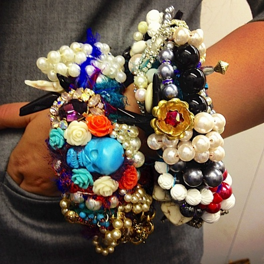 Colourful statement bangles stacked on the wrist illustrating accessories trend