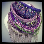 Colourful statement necklace with purple a dominant colour