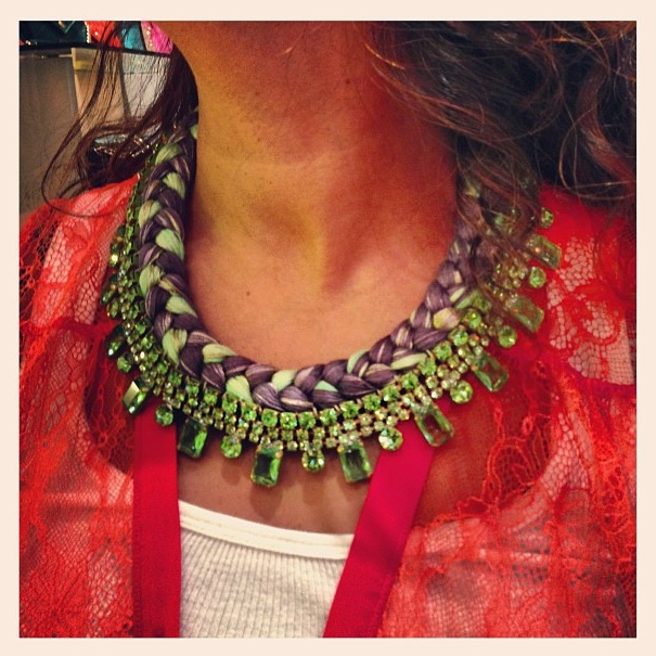 Braided statement necklace made with green rhinestones and charcoal and pastel green silks