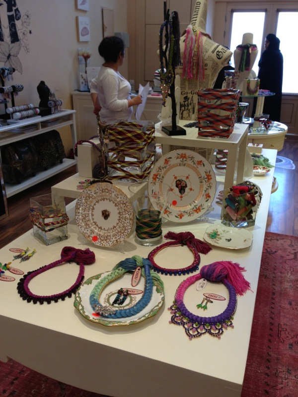 Dadu boutique showcasing Jolita pieces: colourful braided necklace, earrings and skull plates