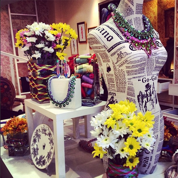 Dadu boutique showcasing Jolita pieces: colourful braided necklaces and skull plates