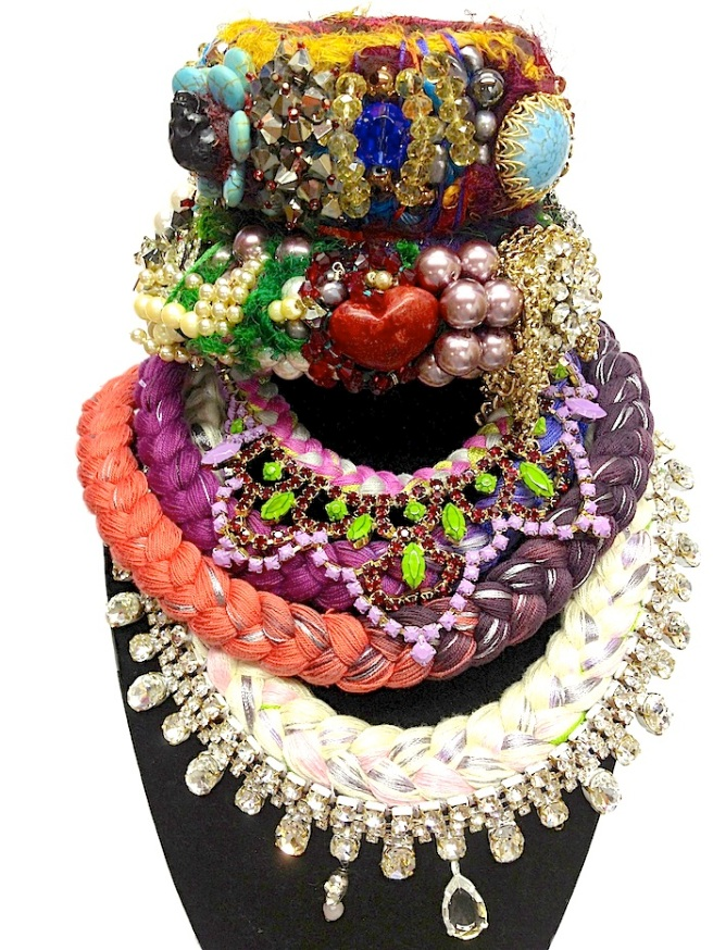 Colourful statement necklaces made with vibrant silk and rhinestones and designer bangles made with new and reclaimed components