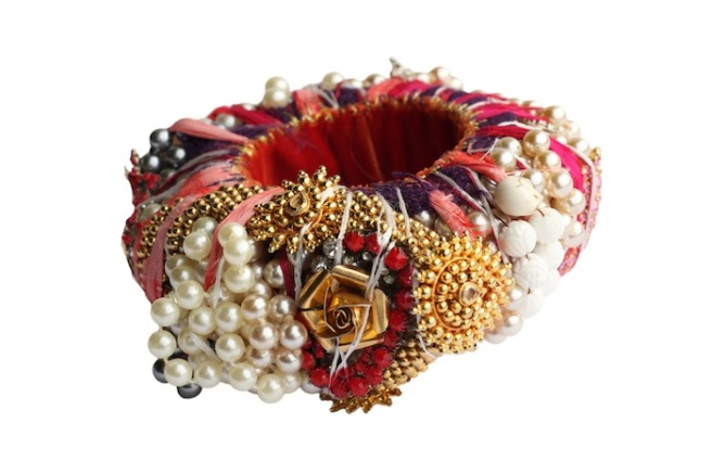 A colourful statement bangle made with vintage and new components like vintage champagne pearls, vintage rhinestones hand-painted in various colours, hand-spun silk and more