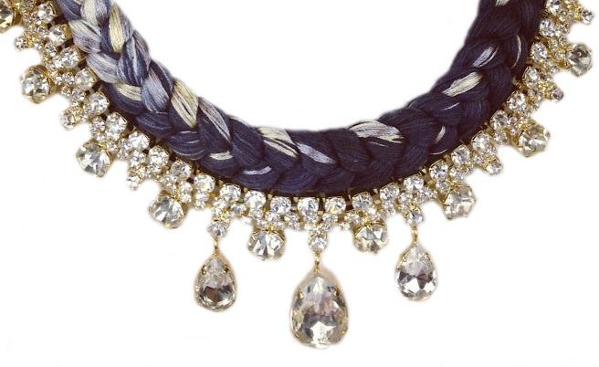 A statement necklace made with clear crystals and dip-dyed silk in nude and charcoal