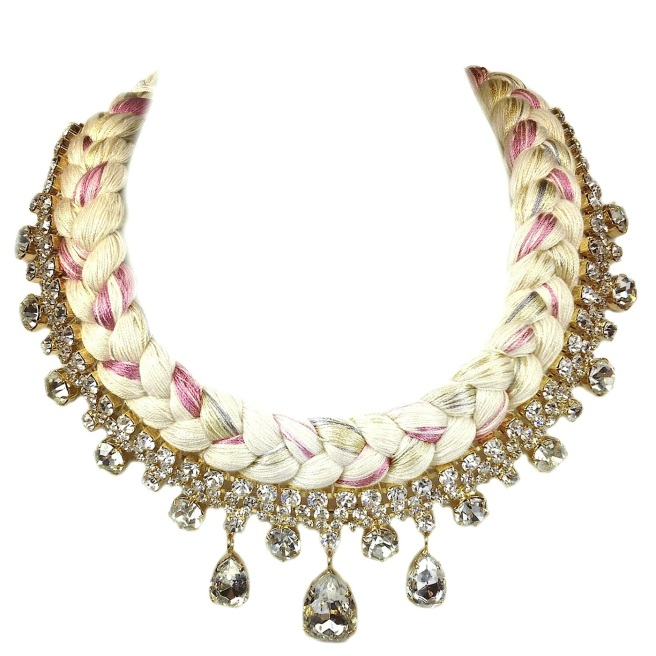 A statement necklace made with clear crystals and nude silk braid, mixing in a hint of purple, grey and gold