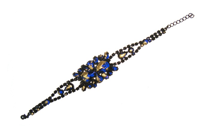 A bracelet, hand-painted in black, cobalt blue and splashed with gold.