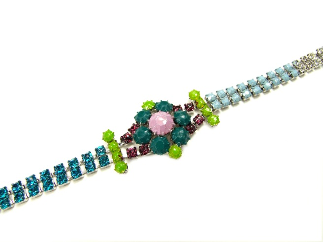 A colourful bracelet hand-painted in various shades of blue, green and purple.