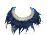 Statement necklace made with crystals, braided silks and feathers.