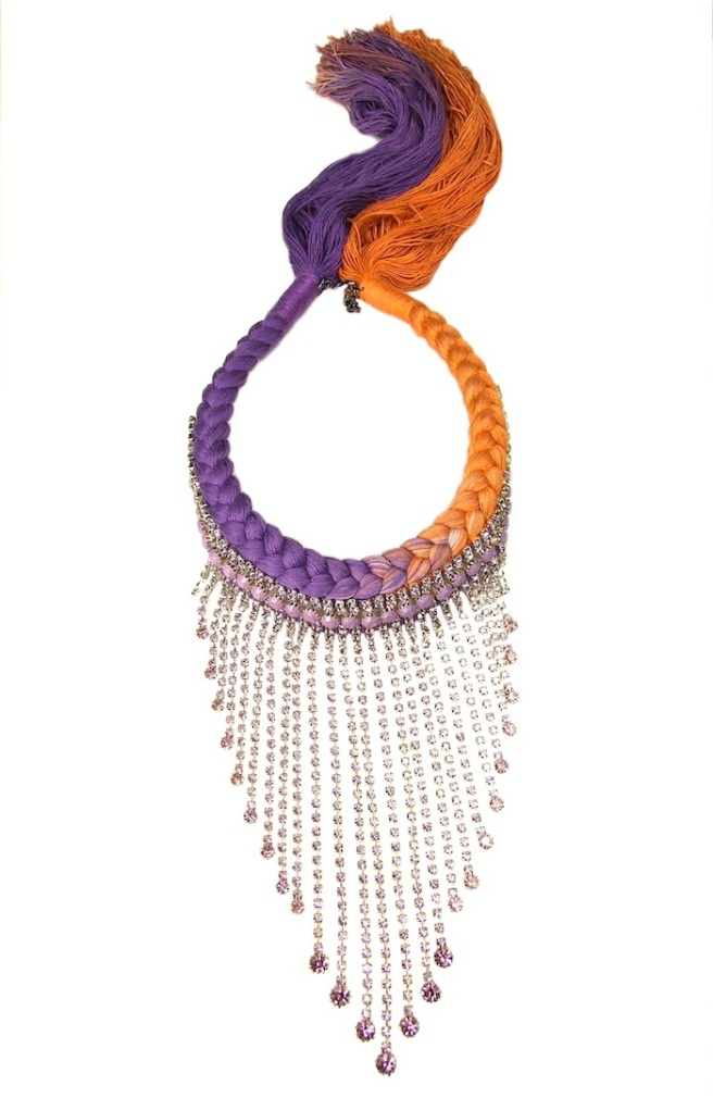 A one-of-a-kind handmade statement necklace made with long Czech crystal drops, part hand-painted and braided with dip-dyed silk in purple and orange.