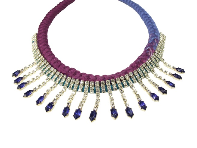Made  with vintage rhinestones, hand-painted by the designer, and silk braid in dip-dyed plum and lilac colours.