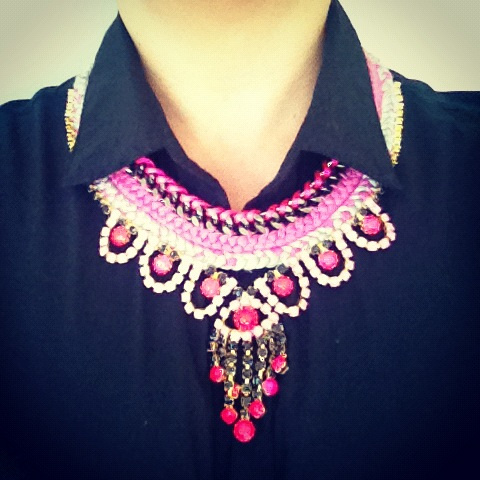 A colourful double collar statement piece made with hand-painted rhinestones, gunmetal chain, braided with silk and neon pink satin.