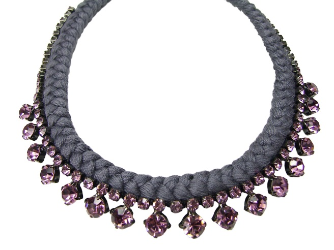 Made with grey silk braided onto a lilac pink rhinestones, this necklace is elegant and light.