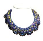 Braided necklace with blue rhinestones and thick braid, made of dark blue silk, mixing in a hint of pink and yellow