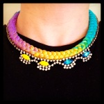 A colourful statement necklace made with bright dip-dyed braid and rhinestones, hand-painted in yellow and blue