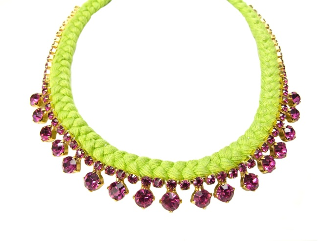 This vibrant necklace is bursting with colours. Made with neon green silk braided onto a hot pink crystal necklace, it's light and bright.