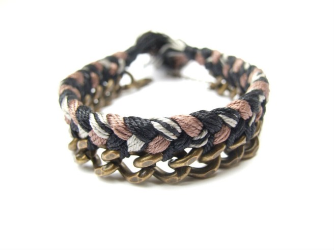 A one-of-a-kind bracelet for men made with vintage brass chain and braided silk in black, cocoa brown and white.