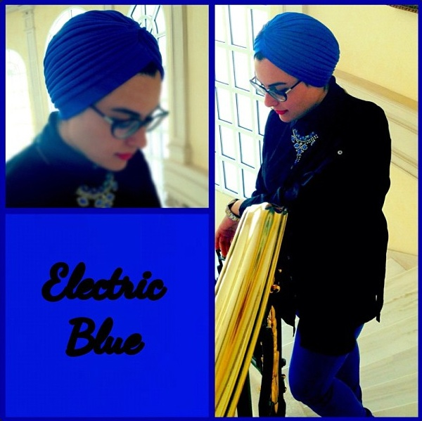 A customer is wearing blue St. Petersburg necklace matching her electric blue turban and trousers