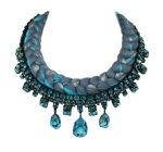 A braided statement necklace in dark grey with a hint of metallic and light blue silks, made with Bohemian glass rhinestones.