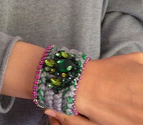 A happy customer from Egypt in a custom made braided cuff with grey and emerald green silk, pink crystals and bigger green crystals as a centrepiece