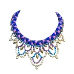 Colourful necklace made by mixing light and dark shades of purple silk and embellished with rhinestones hand-painted in blue, purple and gold