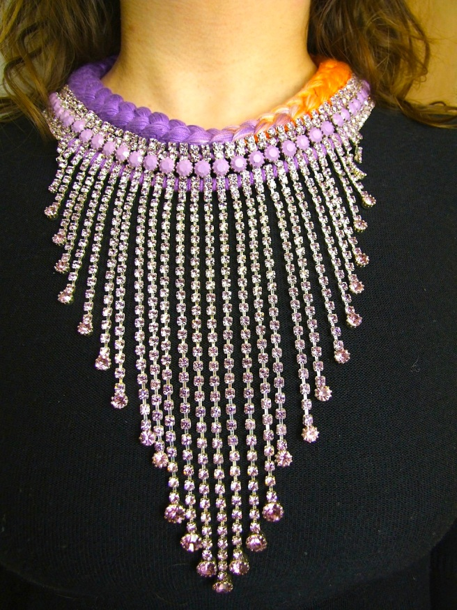 One-of-a-kind handmade statement necklace made with long Czech crystal drops, part hand-painted and braided with dip-dyed silk in purple and orange.