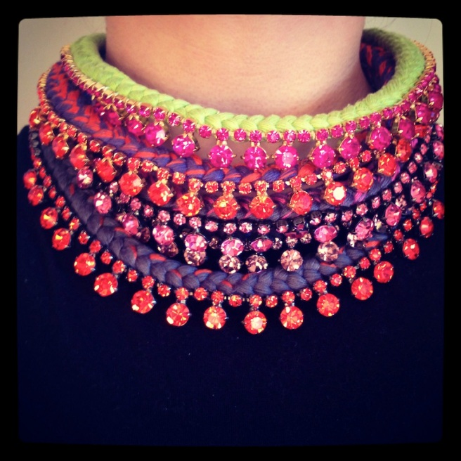 A number of colourful necklaces made with crystals and braided with silk
