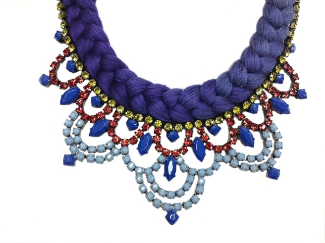 This statement necklace is made with triple dyed silk in various shades of purple and lilac with hand-painted rhinestones