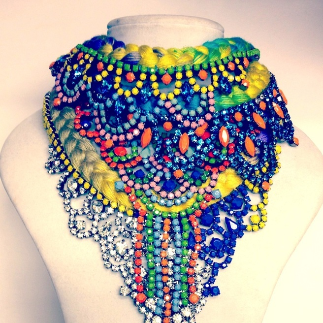 Loads of colourful statement necklaces by Jolita Jewellery layered together in bright silk braids