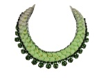 A statement necklace made with dip-dyed silk in chartreuse and light grey, adorned with a chain and green crystals