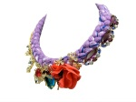 A luxuriou statement necklace made with a lavender silk braid, a handmade silk flower and various rhinestones, some in a shape of bugs, dipped in gold