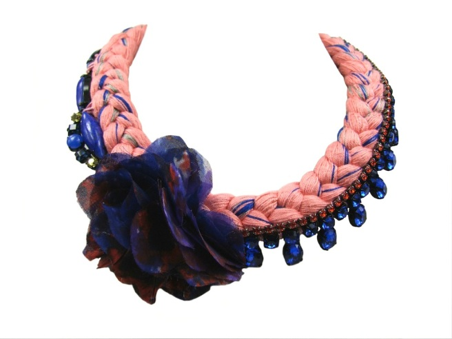 This beautiful statement necklace is made with soft coral pink braid, mixing in a hint of cobalt blue and metallic. The piece is adorned with asymmetrically stitched deconstructed jewels and beautiful hand-made silk flower. Inside the flower there's a little hidden secret - bronze tooth and a cluster of clear Swarovski crystals.
