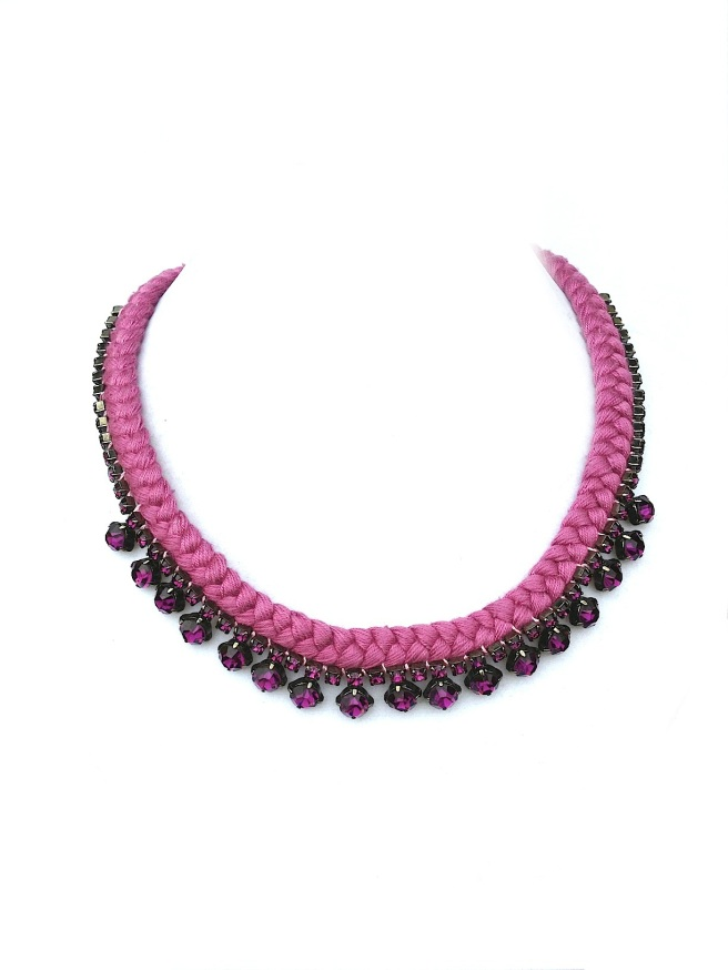 A statement necklace made with raspberry sherbet pink braid and similar colour rhinestones