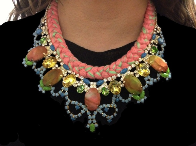A colourful braided statement necklace made with a pastel silk braid, rhinestones, hand-painted in soft pastels, and bigger stones covered in hand-died silk