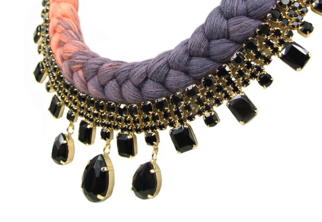 This opulent statement necklace is hand-made with black rhinestones, dipped in gold, and a beautiful dip-dyed coral pink and dark purple grey braid