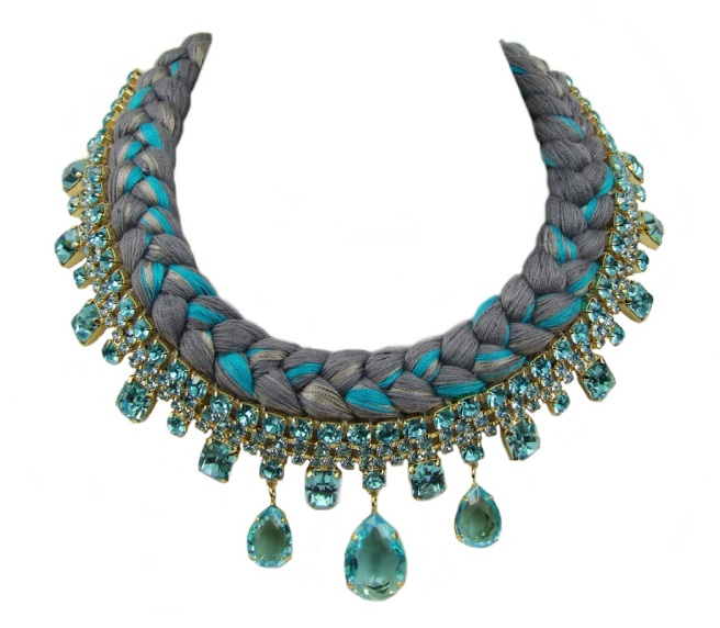 A braided statement necklace in dark grey with a hint of metallic and light blue silks, made with gold-plated Bohemian glass rhinestones.