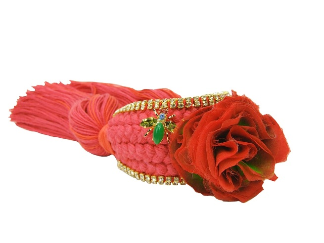 Colourful braided cuff handmade with a crimson silk braid and embellished with small crystals, a handmade silk flower and dipped in gold bugs