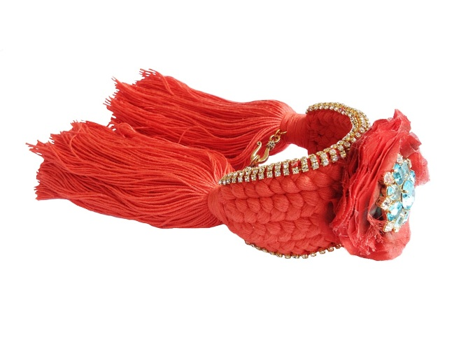 Colourful braided cuff handmade with a red orange silk braid and embellished with small crystals, a handmade silk flower and dipped in gold aquamarine rhinestones in the centre of the flower