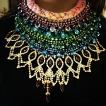 Colourful statement necklaces made with braided silk hand-dyed be the designer and crystals dipped in godl
