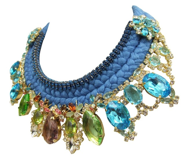 Florence luxury statement necklace by Jolita Jewellery made with a double braid silk collar, embellished with three rows of blue crystals and an array of deconstructed jewels dipped in gold.