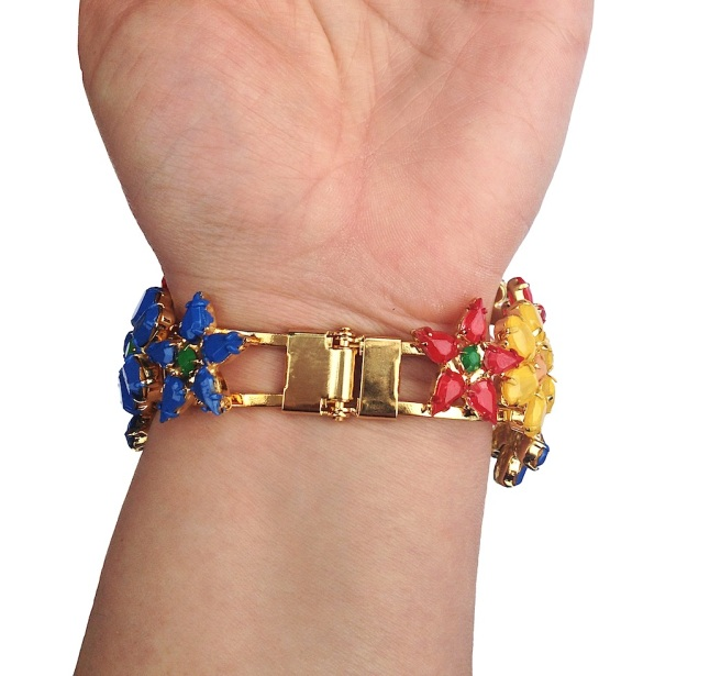 A colourful flower cuff hand-painted in beautiful palette of colours