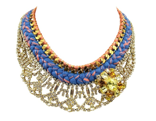 This enchanting piece is made with a number of luxury components, mixing silk and crystals. The blue silk braid with a touch of terracotta is hand-dyed by Jolita Jewellery designer in his London studio, mixing a number of pigments in order to achieve these colours. The silk braid is stitched to a gold-plated chain from one side and a beautiful gold-plated crystal collar from the other. The necklace is embellished with a clear and yellow rhinestones boutonniere, dipped in 18k yellow gold.