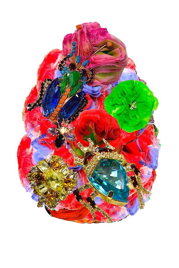 A collage made of hand-made silk flowers, corsages and dipped in gold bugs and boutonniere as used in various Jolita Jewellery pieces