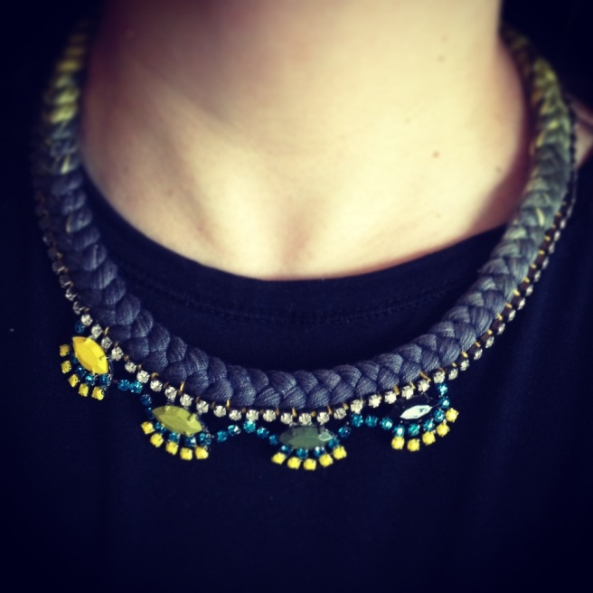 A light and easy to wear Oslo necklace, made with a dip-dyed silk braid in charcoal and yellow and hand-painted rhinestones