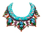 A bright colourful statement necklace made with crystals and silk braid in vivid turquoise mixing in a touch of orange and various shades of pink.