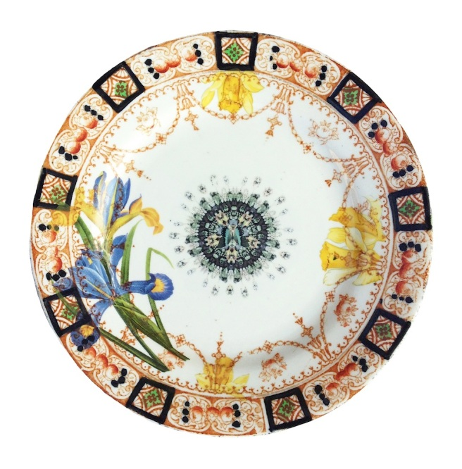 This up-cycled vintage plate is from Jolita Jewellery's Object Trouve collection. It is decorated with contemporary images using floral motives, combined with our signatory skulls and distorted images of our jewellery.