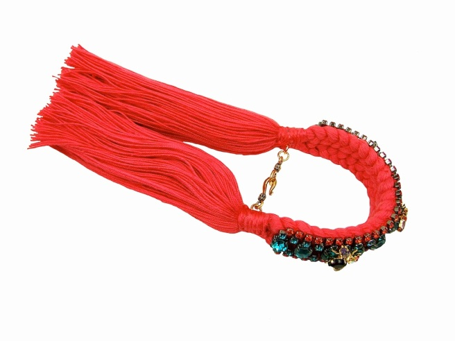 This bright bracelet is handmade with a double crimson silk braid and embellished with a row of aquamarine crystals, two rows of smaller hyacinth colour crystals and three colourful little insects, dipped in 18k gold. The piece secures with a lobster clasp and a chain.