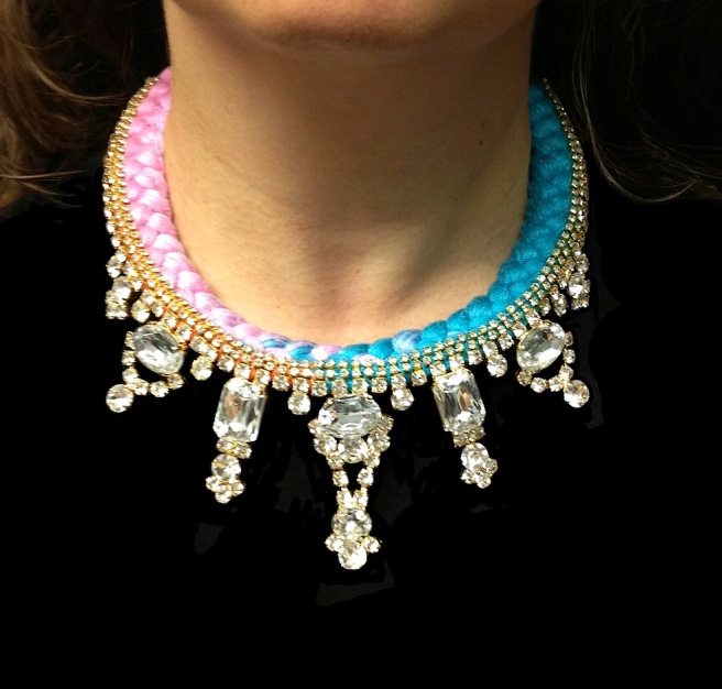 This colourful Dubai statement necklace by Jolita Jewellery is made with a dip-dyed turquoise and pink silk braid and clear crystals dipped in gold.